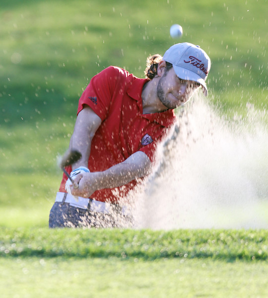 Lowell vs Tyngsboro golf. Lowell's Ben Asselin hits out of a bunker on the 7th hole. (SUN/Julia Malakie)