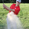Lowell vs Tyngsboro golf. Lowell's Trevor Green hits out of a bunker on the 6th hole. (SUN/Julia Malakie)