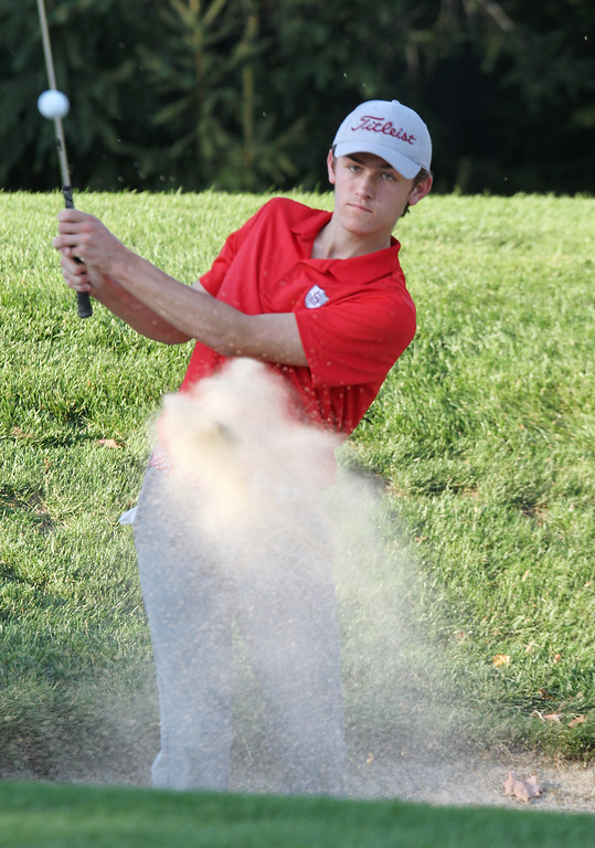 . Lowell vs Tyngsboro golf. Lowell\'s Trevor Green hits out of a bunker on the 6th hole. (SUN/Julia Malakie)