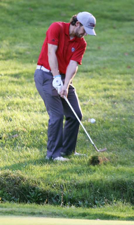 . Lowell vs Tyngsboro golf. Lowell\'s Ben Asselin hits a chip shot over the creek but into a bunker on the 7th hole. (SUN/Julia Malakie)