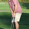 Lowell vs Tyngsboro golf. Tyngsboro's Kevin Carpenter putts at 6th hole. (SUN/Julia Malakie)