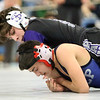 MIAA Division 1 North Sectional championships at Methuen High School. Frank Foti of Shawsheen Tech, top, won by pin over Nick Curley of St. John's Prep in their 106 lb. semifinal. (SUN/Julia Malakie)