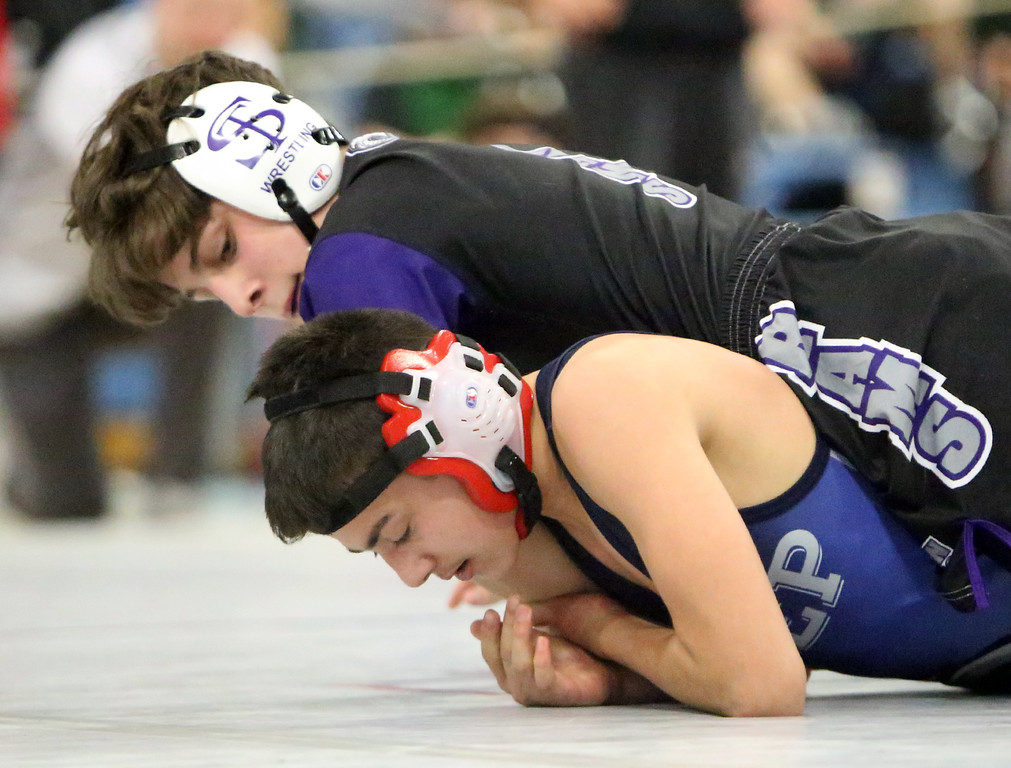 . MIAA Division 1 North Sectional championships at Methuen High School. Frank Foti of Shawsheen Tech, top, won by pin over Nick Curley of St. John\'s Prep in their 106 lb. semifinal. (SUN/Julia Malakie)
