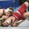 MIAA Division 1 North Sectional championships at Methuen High School. Max Chernauskas of Westford Academy won by technical fault (17-1) over Adrian Cintron of Lowell in 170 lb round. (SUN/Julia Malakie)