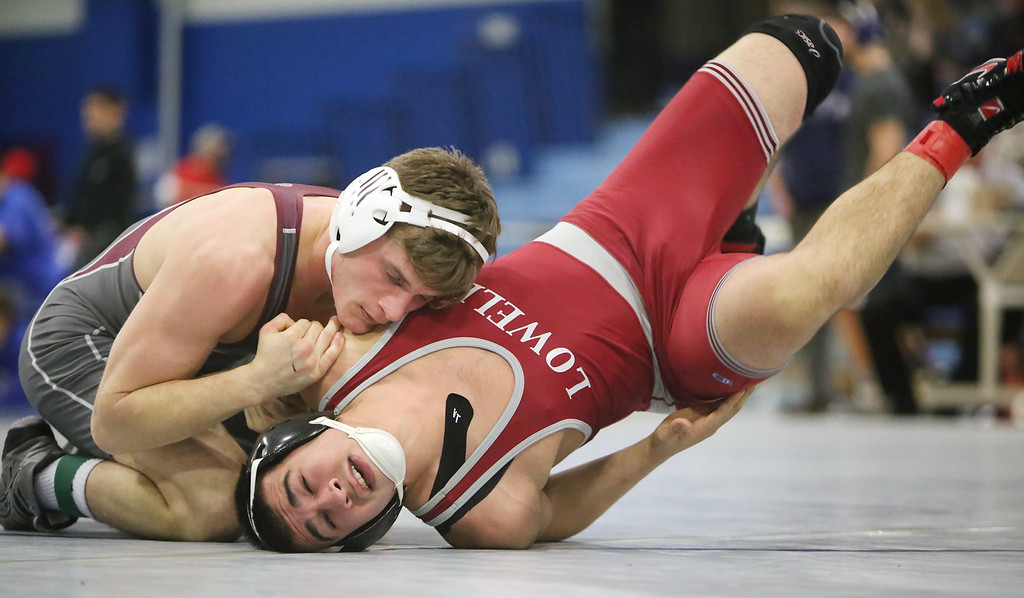 . MIAA Division 1 North Sectional championships at Methuen High School. Max Chernauskas of Westford Academy won by technical fault (17-1) over Adrian Cintron of Lowell in 170 lb round. (SUN/Julia Malakie)