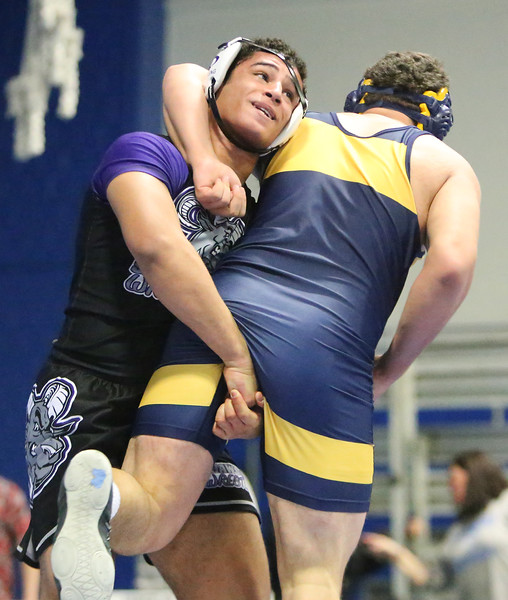 MIAA Division 1 North Sectional championships at Methuen High School. Omar Eldaly of Shawsheen Tech, left, won 9-4 over Ethan Coyle of Andover, right, in 220 lb quarter final. (SUN/Julia Malakie)