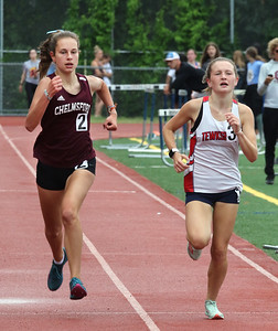 MVC track & field championships. Chelmsford's Malena Lombardo, left, and Tewksbury's Molly Cremin race to the finish line in a heat of the giirls mile.  SUN/Julia Malakie
