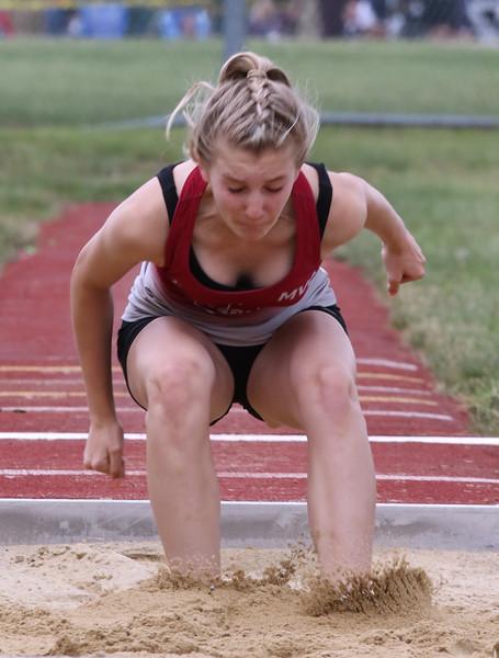 MVC track & field championships. Lowell's Quinn Petzold competes in triple jump.  SUN/Julia Malakie