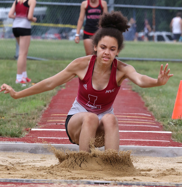 MVC track & field championships. Lowell's Annamaria Mbuyu competes in triple jump.  SUN/Julia Malakie    NOTE: coach said she was likely winner of event.