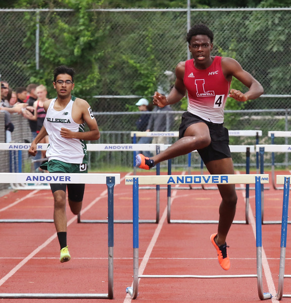 MVC track & field championships. Aditya Heera of Billerica and Nidlaire Olivier of Lowell compete in a heat of the 400M hurdles.  SUN/Julia Malakie