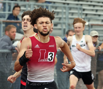 MVC track & field championships. Izaiah Strum of Lowell finishes just ahead of Tyler Bussell of North Andover in the fast heat of the 400M hurdles. At rear is Colton Jacques of Billerica.  SUN/Julia Malakie