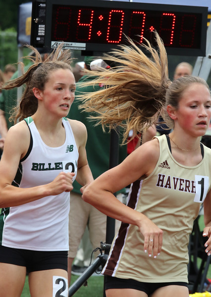 MVC track & field championships. Billerica's Anna McElhinney and Haverhill's Finleigh Simmonds start the bell lap in their heat of the girls mile.  SUN/Julia Malakie