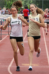MVC track & field championships. Billerica's Anna McElhinney and Haverhill's Finleigh Simmonds cross the finish in their heat of the girls mile. Simmonds won and McElhinney was second. SUN/Julia Malakie
