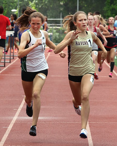 MVC track & field championships. Billerica's Anna McElhinney and Haverhill's Finleigh Simmonds race to the finish in their heat of the girls mile. Simmonds won and McElhinney was second. SUN/Julia Malakie