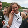 MVC track & field championships. Billerica's Anna McElhinney is surrounded by teammates after finishing a close second in the girls mile. SUN/Julia Malakie