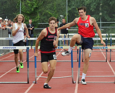 MVC track & field championships. Brad Glasford of Chelmsford, Owen Phelan of North Andover, and Dom Valway of Tewksbury finish a heat of the 400M hurdles.  SUN/Julia Malakie