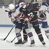 Methuen-Tewksbury vs Reading girls hockey. Methuen-Tewksbury's Lydia Pendleton (5) and Reading's Abbie Collins. (SUN/Julia Malakie)