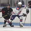 Methuen-Tewksbury vs Reading girls hockey. Reading's Chloe Doherty (22) and Methuen-Tewksbury's Cassidy Gruning (4). (SUN/Julia Malakie)