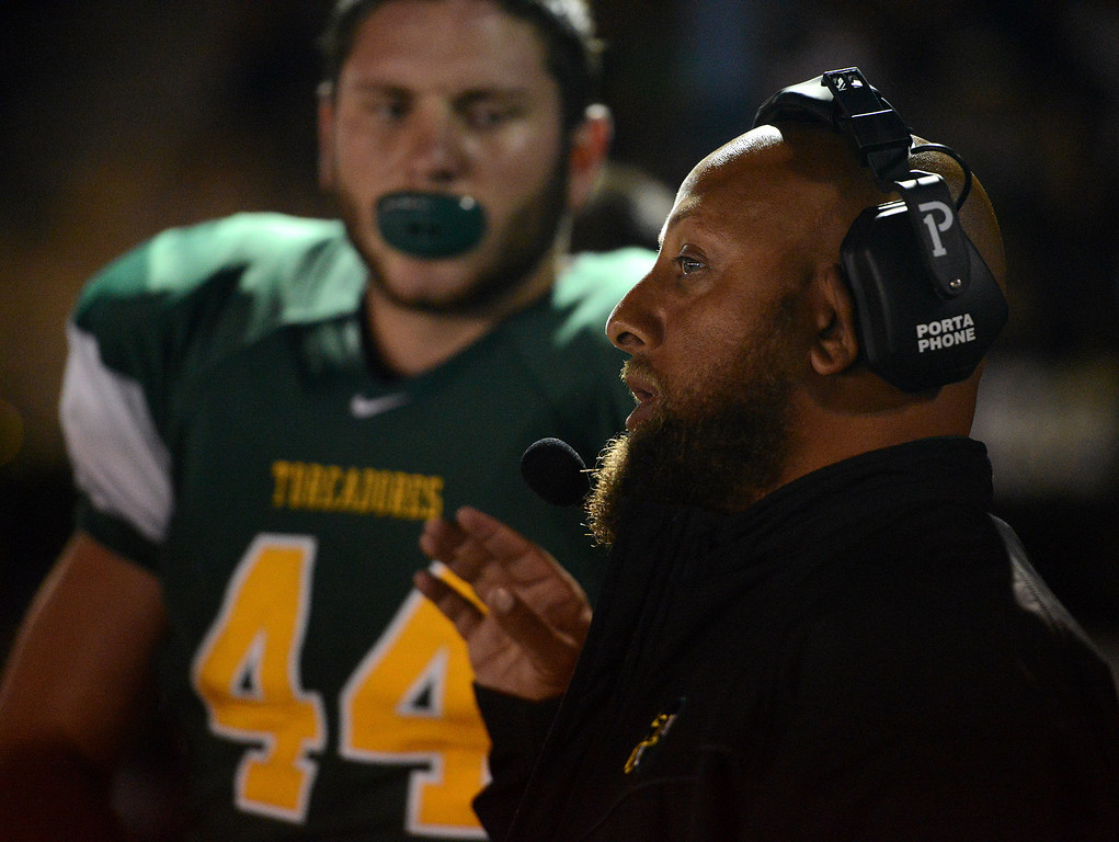 . Monterey assistant coach Jimmy Hill speaks with player Joseph Pryor during football against Pacific Grove in Monterey, Calif. on Friday September 20, 2013.  (Photo David Royal/ Monterey County Herald)