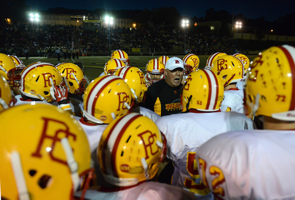 . Pacific Grove head coach Chris Morgan rallies his team during football in Monterey, Calif. on Friday September 20, 2013.  (Photo David Royal/ Monterey County Herald)