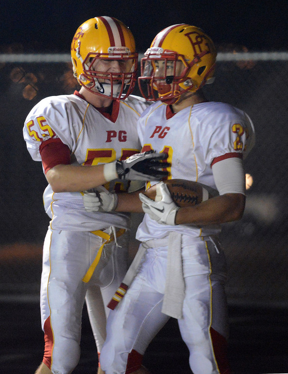. Pacific Grove\'s Jake Speed, right, is greeted by teammate Austin Lord after running in a first quarter touchdown during football in Monterey, Calif. on Friday September 20, 2013.  (Photo David Royal/ Monterey County Herald)