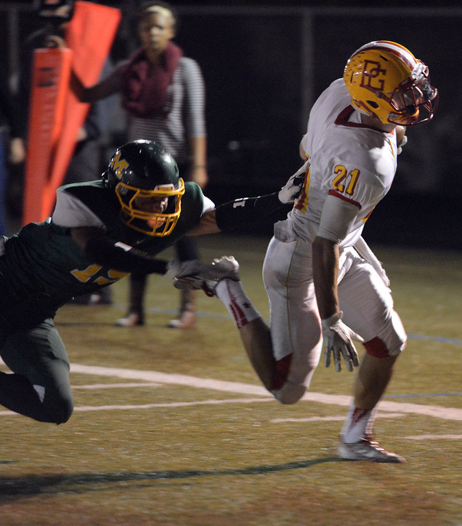 . Pacific Grove\'s Jake Speed runs in a first quarter touchdown in front of Monterey\'s Brandon Finona during football in Monterey, Calif. on Friday September 20, 2013.  (Photo David Royal/ Monterey County Herald)