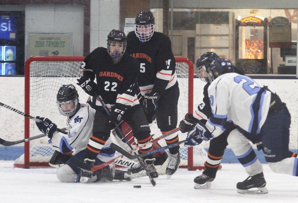 . Nashoba Tech vs Gardner boys hockey.  Nashboba Tech\'s Ryan Silva (7), left, and Matt Venti (20), right, with Gardner\'s Josh Garrity (22), Matt Benedict (15) and Phillip Quinn (3), rt, defending. (SUN/Julia Malakie)