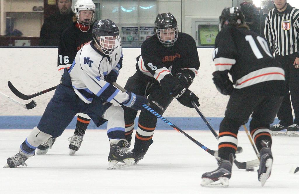 . Nashoba Tech vs Gardner boys hockey. Nashoba Tech\'s Matt Ringdahl (24) and Gardner\'s Ben Savoie (8) and Nick Maillet (10), right, and Max Murphy (16), rear. (SUN/Julia Malakie)