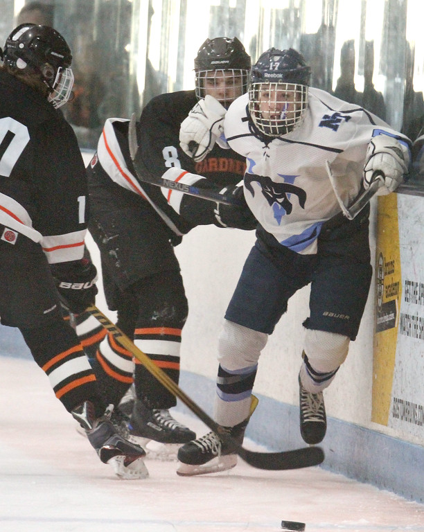 . Nashoba Tech vs Gardner boys hockey. Nashoba Tech\'s Connor Lefebvre (17) and Gardner\'s Nick Miallet (10, left, and Ben Savoie (8).  (SUN/Julia Malakie)