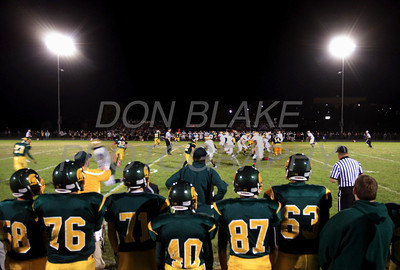 St. Mark's players on the sidelines watch the game during first home football game under the lights at St. Mark's High School. photo/DonBlakePhotography.com