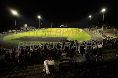 People sit on the hill as they watch St. Mark's versus Newark during first home football game under the lights at St. Mark's High School. photo/DonBlakePhotography.com
