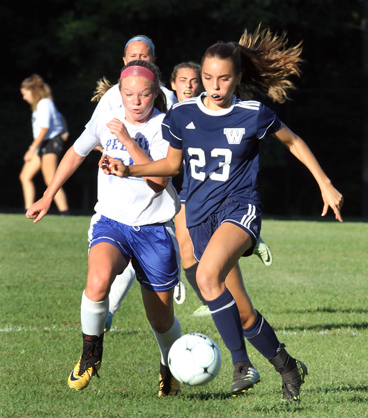 Pelham vs Windham girls soccer. Pelham's Elyce Jedraszek (25) and Windham's Kate Burzlaff (23). (SUN/Julia Malakie)