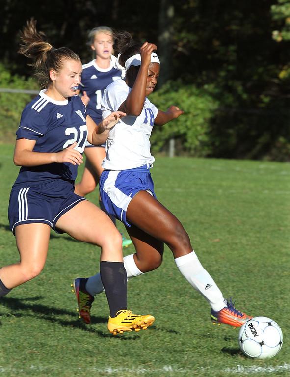 . Pelham vs Windham girls soccer. Windham\'s Grace Harootian (20) and Pelham\'s Cheyenne Lee (18). (SUN/Julia Malakie)
