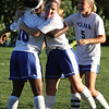 Pelham vs Windham girls soccer. From left, Pelham's Cheyenne Lee (18), Brianna Trudel (16) and Olivia Gagnon (5) celebrate goal by Lee that tied game 1-1 in the second half. (SUN/Julia Malakie)