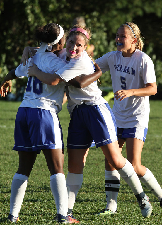. Pelham vs Windham girls soccer. From left, Pelham\'s Cheyenne Lee (18), Brianna Trudel (16) and Olivia Gagnon (5) celebrate goal by Lee that tied game 1-1 in the second half. (SUN/Julia Malakie)