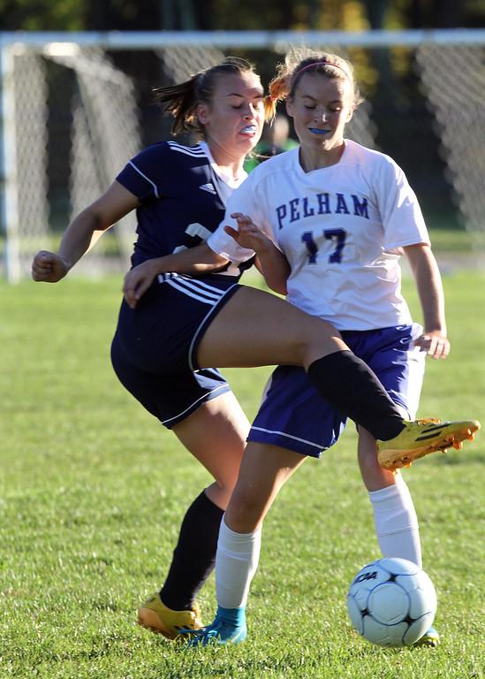 . Pelham vs Windham girls soccer. Windham\'s Grace Harootian (20) and Pelham\'s Madison Burke (17). (SUN/Julia Malakie)