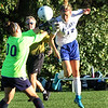 Pelham vs Windham girls soccer. Windham goalie Olivia Gomes, and Pelham's Madison Burke (17). (SUN/Julia Malakie)