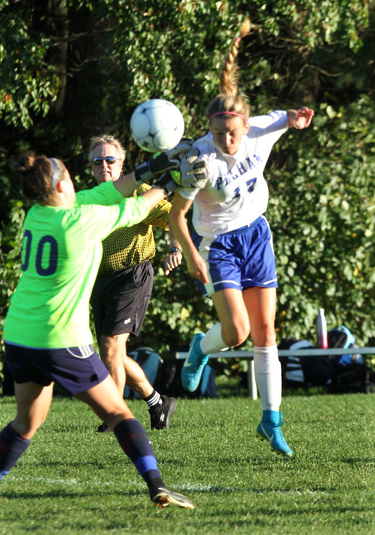 . Pelham vs Windham girls soccer. Windham goalie Olivia Gomes, and Pelham\'s Madison Burke (17). (SUN/Julia Malakie)