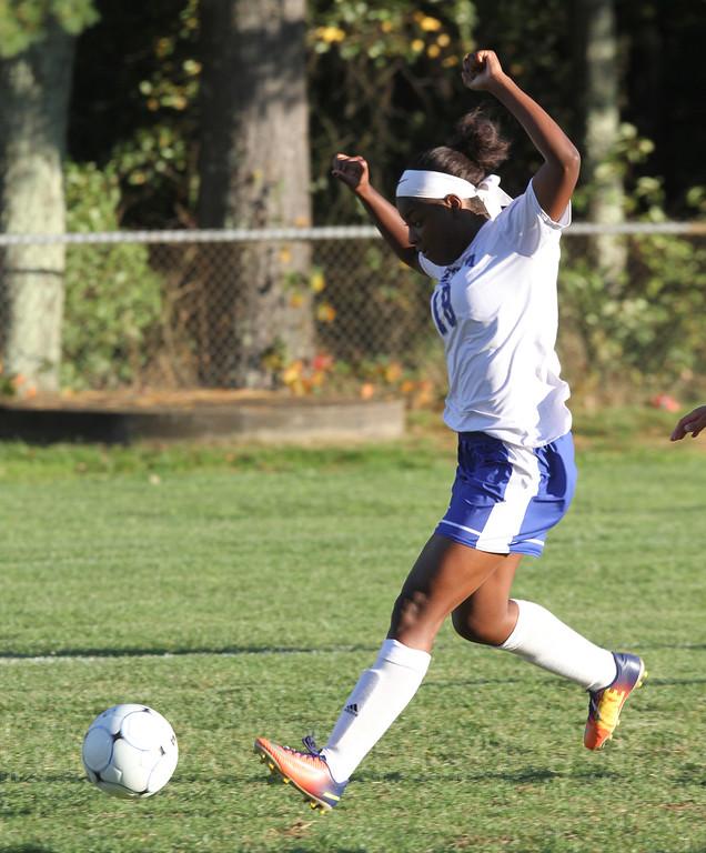 . Pelham vs Windham girls soccer. Pelham\'s Cheyenne Lee (18) scoring goal that tied game 1-1 in the second half. (SUN/Julia Malakie)