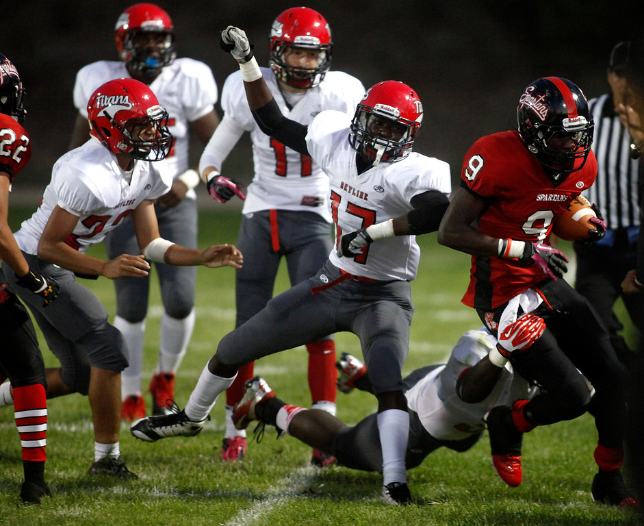 . Seaside\'s Kordell Reed is forced out of bounds by a Skyline player on a carry during football in Seaside, Calif. on Friday September 6, 2013. Photo David Royal/ Monterey County Herald)