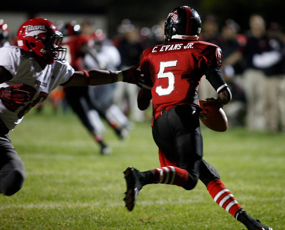 . Seaside quarterback Chris Evans Jr. works under pressure from Skyline during football in Seaside, Calif. on Friday September 6, 2013. Photo David Royal/ Monterey County Herald)