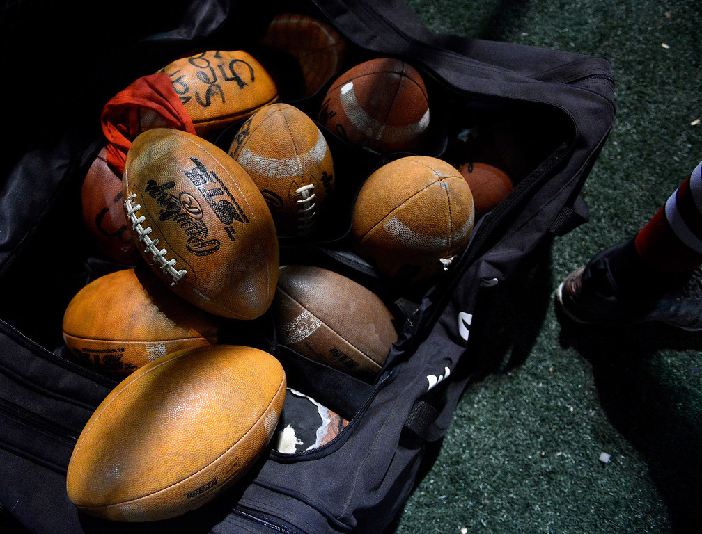 . A bag of footballs sit on Seaside\'s sideline during football at Salinas on Friday October 18, 2013. (Photo David Royal/ Monterey County Herald)