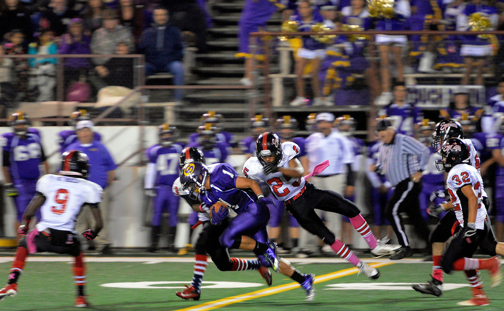 . Salinas Jordan Torres blasts by Seaside\'s James Montgomery returning a kickoff during football at Salinas on Friday October 18, 2013. (Photo David Royal/ Monterey County Herald)