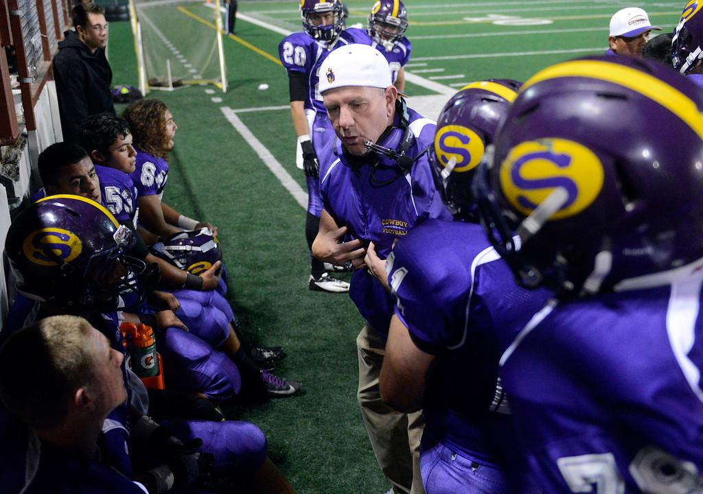 . Salinas players receive coaching during football at Salinas on Friday October 18, 2013. (Photo David Royal/ Monterey County Herald)