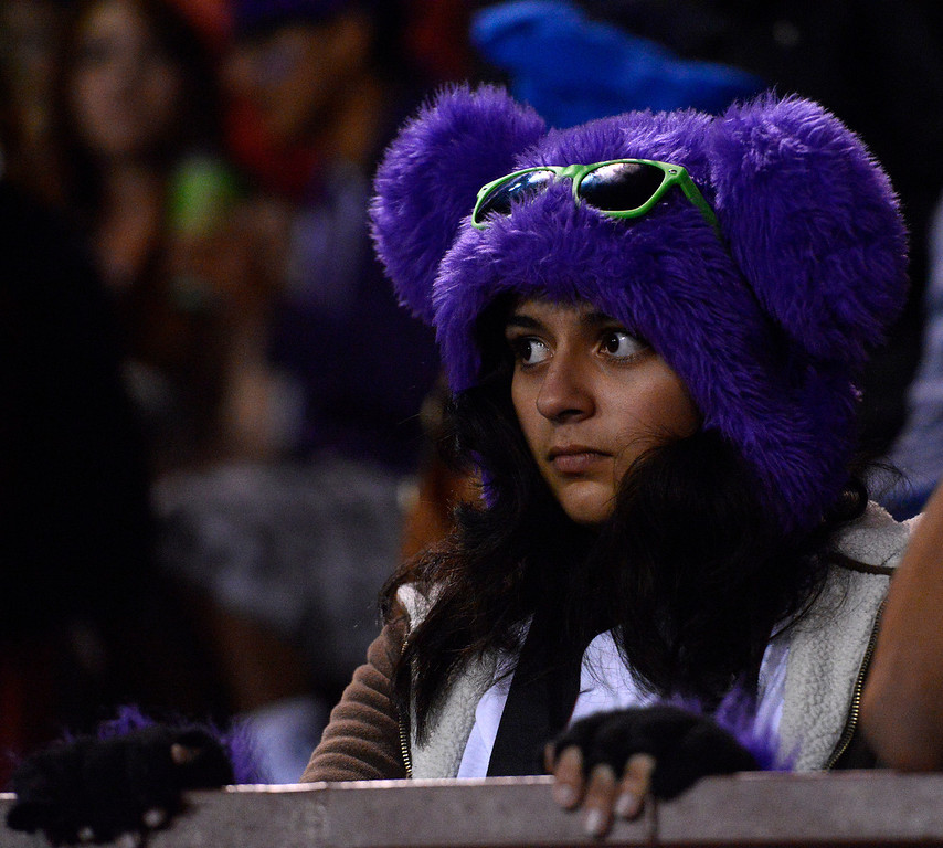 . Salinas fan Jaqueline Gastelum watches during football against Seaside at Salinas on Friday October 18, 2013. (Photo David Royal/ Monterey County Herald)