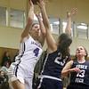 Shawsheen Tech vs Essex Tech girls basketball. Shawsheen's Steph Mercurio (4) and Essex's Riley Mannion (23) and Kristen Curley (13). (SUN/Julia Malakie)