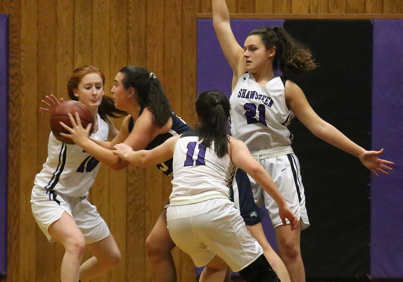 Shawsheen Tech vs Essex Tech girls basketball. Shawsheen's Jess Stevens (10), Ashlyn Bisso (11) and Kelley DeLosh (21), and Essex's Riley Mannion (23). (SUN/Julia Malakie)