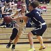 Shawsheen Tech vs Essex Tech girls basketball. Shawsheen's Ashlyn Bisso (11), and Essex's Briana Pothier (3). (SUN/Julia Malakie)