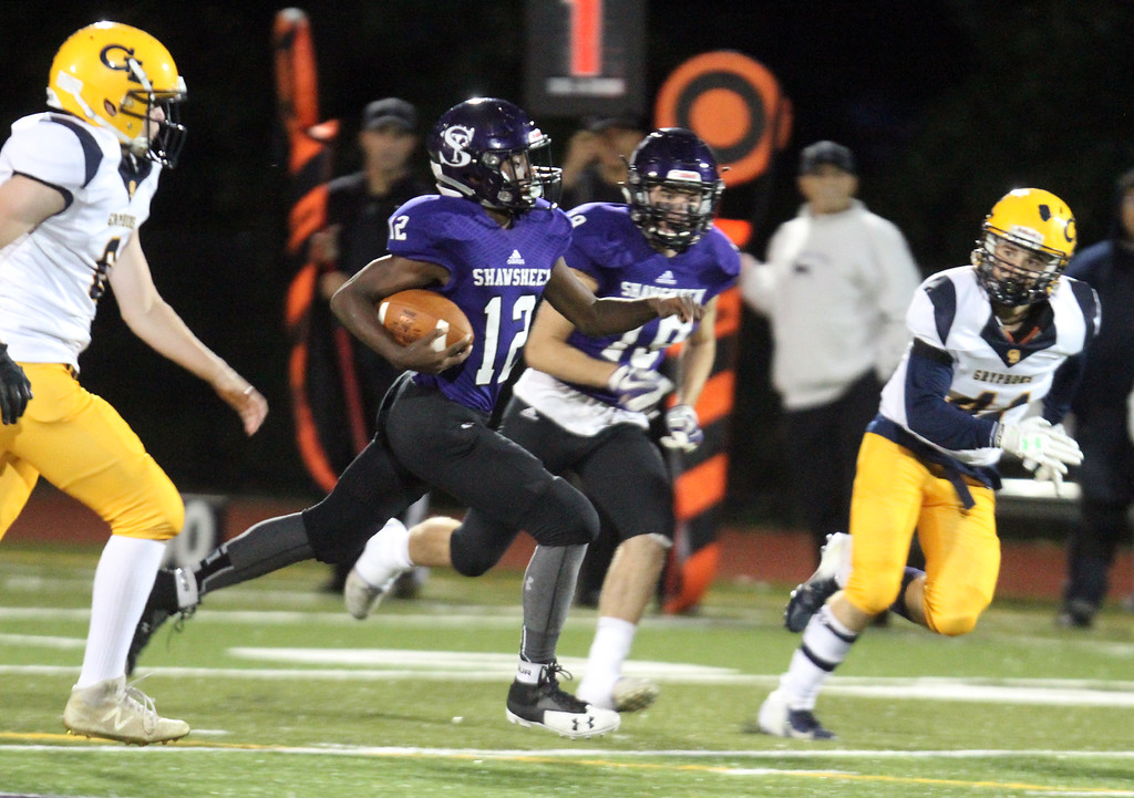 . Shawsheen Tech vs Greater Lowell Tech football. Shawsheen Tech\'s Diondre Turner (12), on an 85-yard TD run on the opening kickoff of the game. (SUN/Julia Malakie)