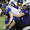 Shawsheen Tech vs Assabet Valley football. Shawsheen's Aidan Leffler (75) tackles Assabet's Cole Nelson (6).  (SUN/Julia Malakie)